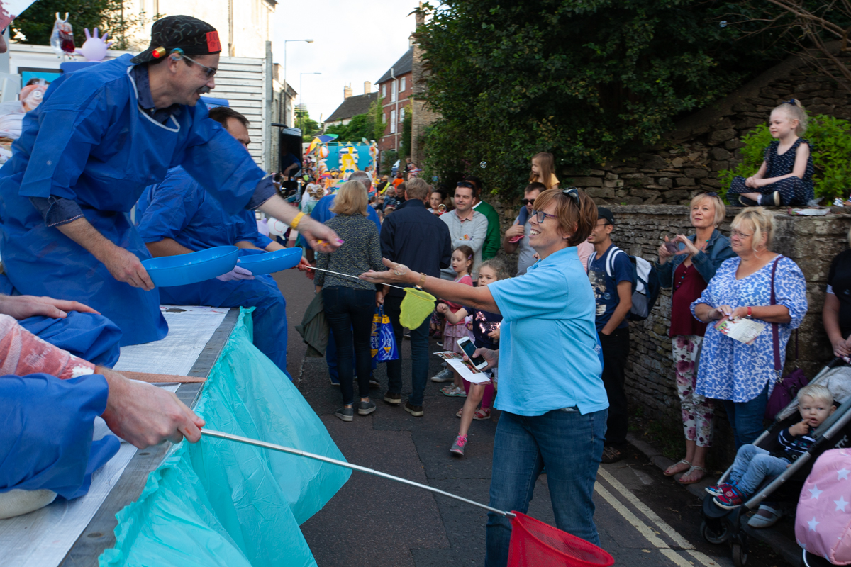 Hilditch handing out money at Malmesbury Carnival 2019
