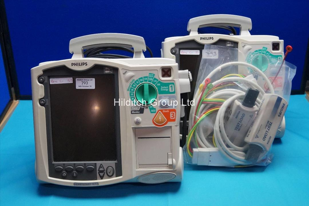 2 x Philips Heartstart MRX Defibrillators with Battery, ECG and Test Loader | SN US00321456 | SN US00321472 | DOM 11/2007 | DOM 11/2007